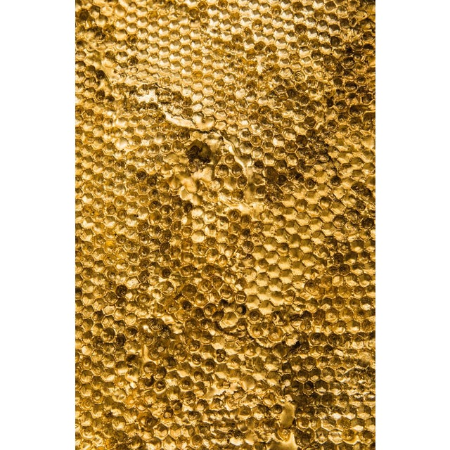 Dossel is comprised of a horizontal panels of layered, cast Jesmonite honeycomb, that have been gilded with 23.5 ct gold...