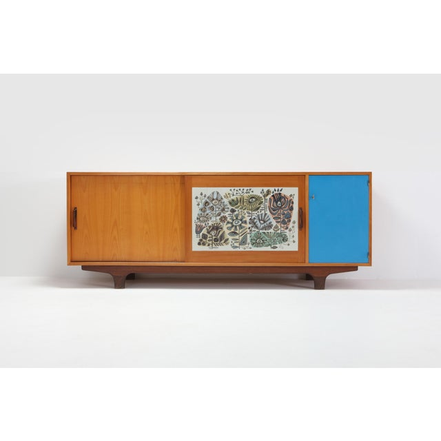 Mid-century modernist credenza with sliding doors from the 1950s, Belgium. The sideboard shows some very prolific details...