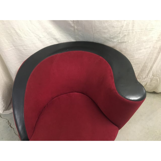 Striking two-toned version of this classic Kagan chair in red microfiber and black leatherette material. It is in...
