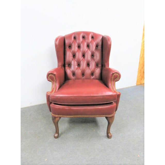 Hickory Leather tufted wing back chair, Queen Anne style legs , brass nail head trim