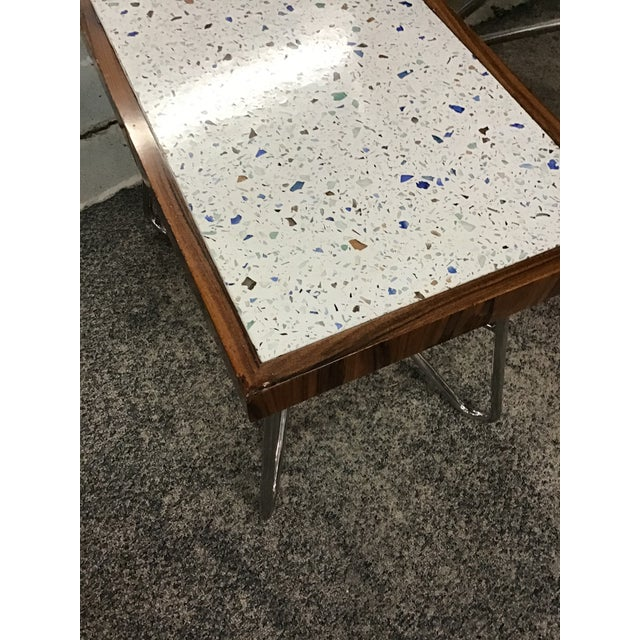 Whimsical Starburst side table by Resource Decor will bring out the kid in you. Spotted color Formica with wood trim on...