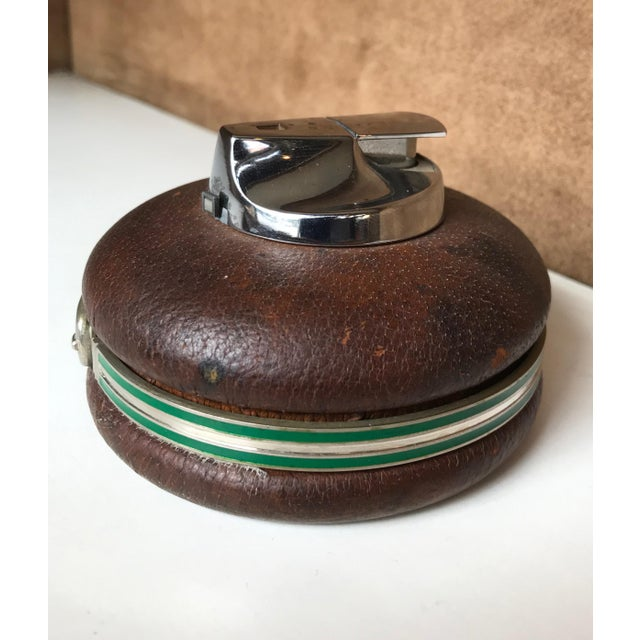 Spherical Leather Gucci Lighter, Made in Italy 1980s A stylish circular silver leather lighter by Gucci, with a leather...