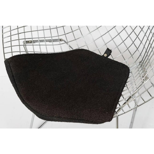 This iconic chair was designed by Harry Bertoria for Knoll International and retains its original black wool crepe seat...