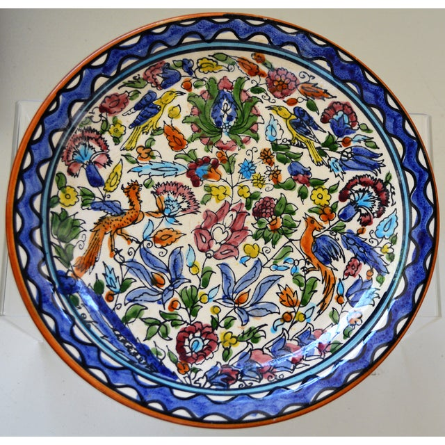 A handmade, hand-painted, one-of-a-kind Majolica ceramic plate. Made of European red clay, fired, dipped in a white,...