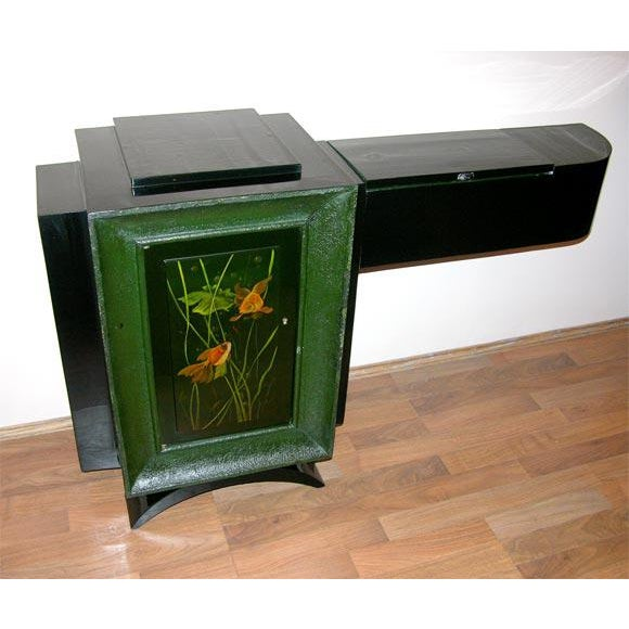 An unusual asymmetrical cabinet designed by René Drouet and decorated by Gaston Suisse from circa 1930s, at the time being...