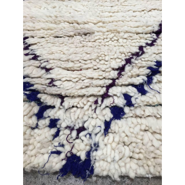 Moroccan Beni Ouarain Tribal Rug. Organic white rug with black tribal designs. Handwoven by Berber women in Morocco....