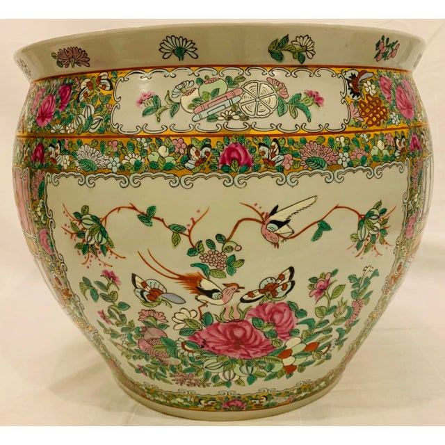 Beautifully handpainted Famille Rose canton style fishbowl planter. Gold gilt detailing is eye catching. This large piece...