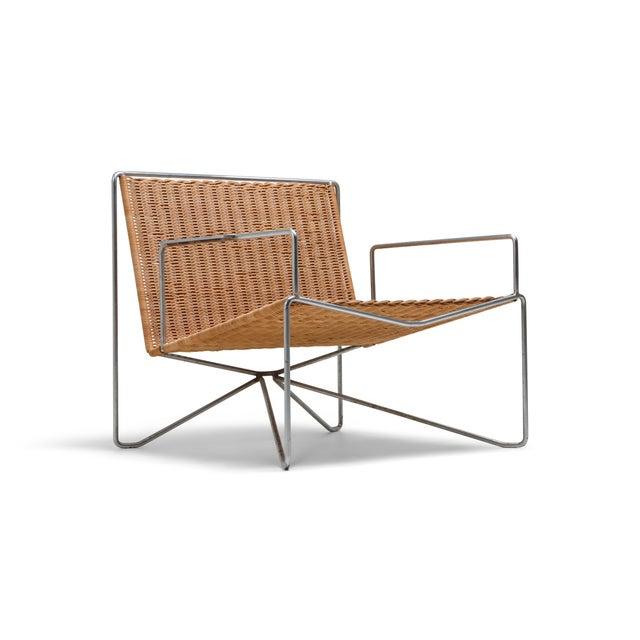 Modern easy chairs in steel and wicker by Gelderland, designed by Design Team Gelderland. Very futuristic design for 1964,...
