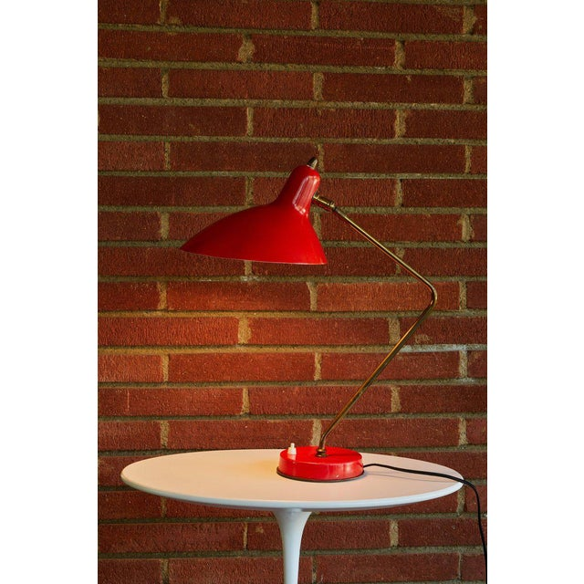 1950s Boris Lacroix table lamp. This rare and elegant table lamp is executed in red metal and brass, France, circa 1950s....