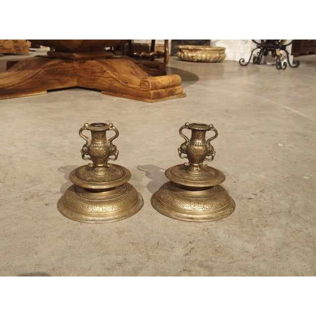 """This pair of small 19th century bronze candlesticks (""""bougeoirs"""" in French) was crafted in the Renaissance style. The..."""