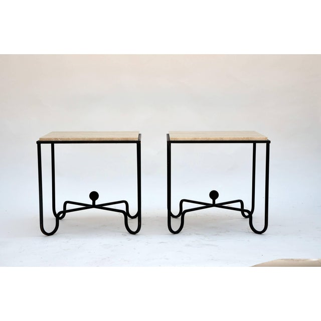 Pair of wrought iron and travertine 'Entretoise' side tables by Design Frères. Chic pair of versatile side/end tables....