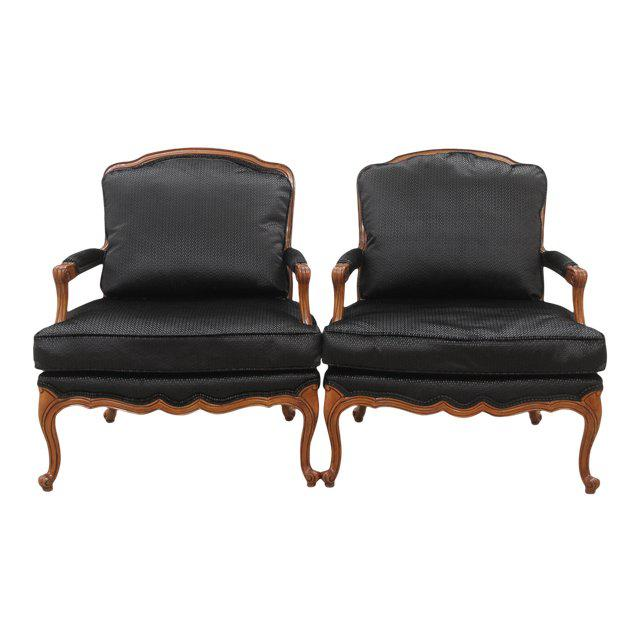 A pair of Louis XV style French armchairs. Newly upholstered in front and on the seat cushion with Clarke & Clarke's...