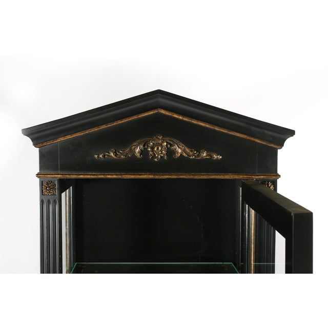 Mid 20th century wood ebonised and gilt details decorated cabinet / vitrines . Each cabinet is in good vintage condition ....