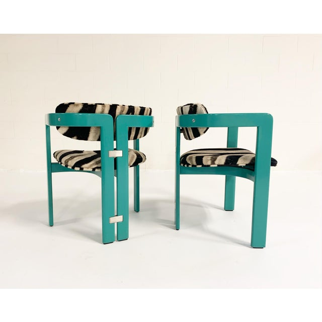 This is a very very cool set of Augusto Savini for Pozzi 'Pamplona' dining chairs. The chairs have a unique and...