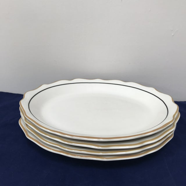 Vintage Syracuse made, big oval serving plates with scalloped borders, yellow and black lining. Made in the mid 20th century.