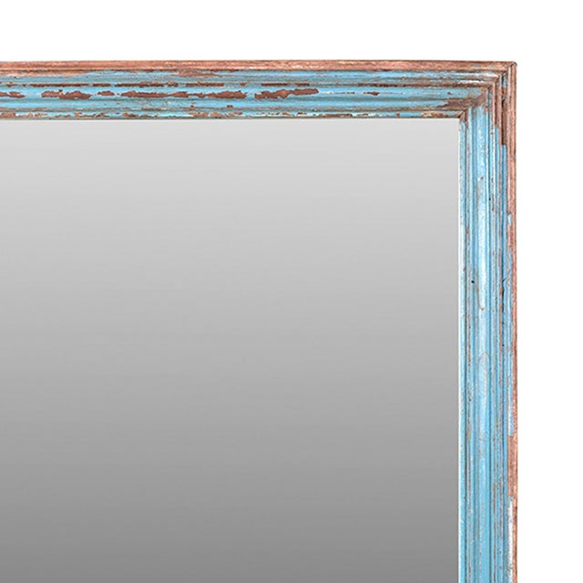 This unique mirror is made from antique moulding. The hard wood has a gentle turquoise patina.