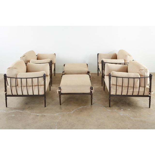 Stately set of four oversized lounge chairs and two ottomans constructed from bronzed solid aluminum. Designed by Michael...