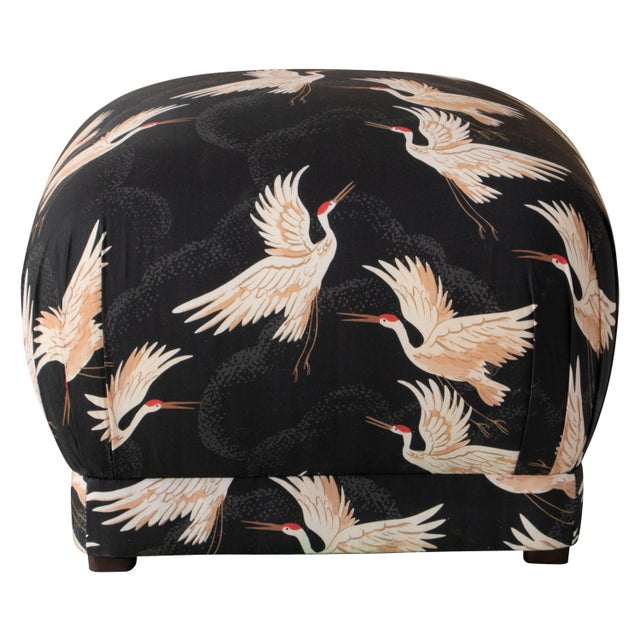 Smooth upholstery covers a sleek cushioned silhouette accentuated at the corners with delicately handcrafted pleating. The...