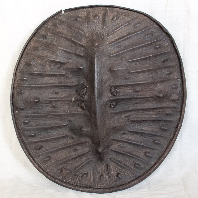 Large African leather war shield attributed to the Arussi tribe of Ethiopia. Piece is made from very thick and durable...