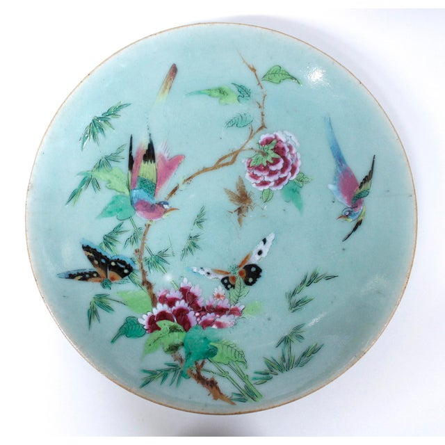Two in good condition with some rubbing to the glazes, the third, most decorative plate with the large pheasant profile,...