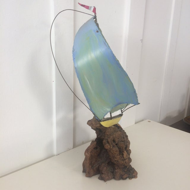 Beautiful brass sail boat on burl wood sculpture. Has been hand painted by a previous owner at some point in its life. Is...
