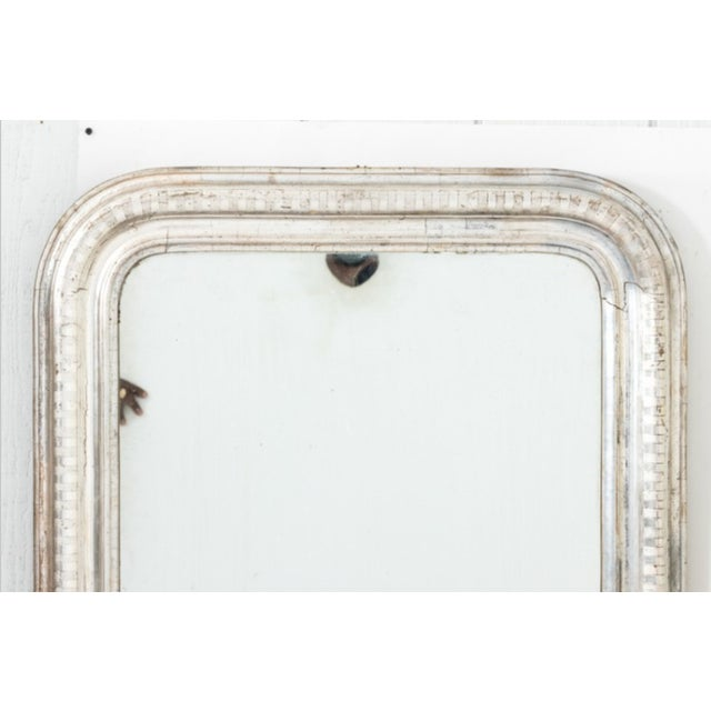 Circa 1850s Louis Phillip mirror with silver gilt and original glass. Please note of wear to age to the mirror plate. This...