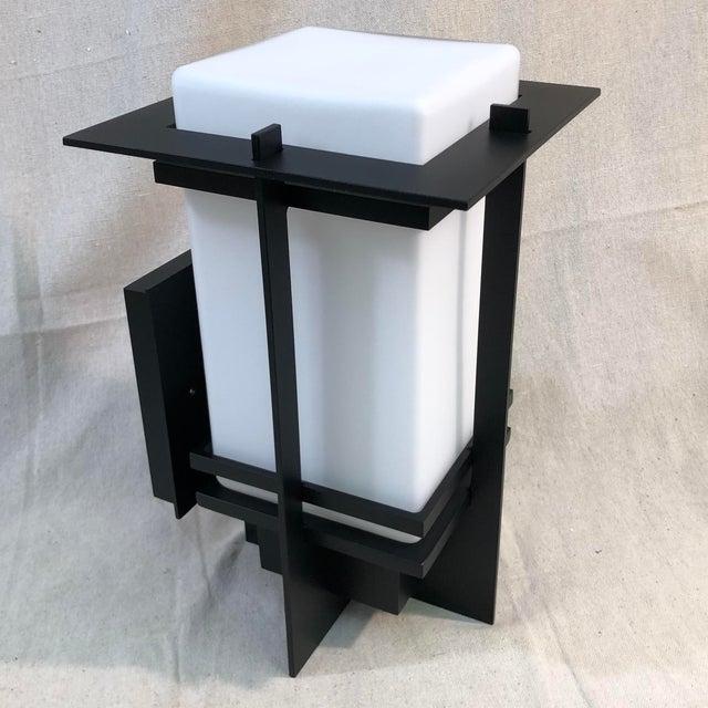 Hubbardton Forge Tourou Outdoor Wall Light Lantern - Showroom Sample This sleek wall lantern features an aluminum body...