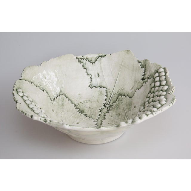 A Mid-Century Italian majolica hand made bowl decorated with lovely grapes and leaves. Marked Bassano Italy on reverse....