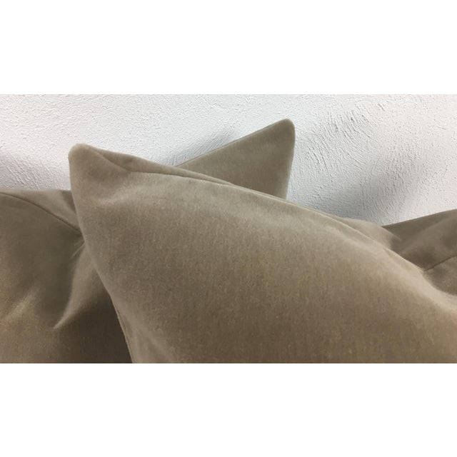 This is a pair of taupe mohair pillows with undertones of gray and blue, The same fabric is on both sides with clean edge....