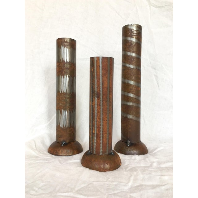 This unique set of three industrial modern vases each has a distinctive design motif. Display them as a set of vases, or...