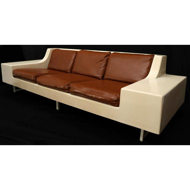 Mid-Century Modern fiberglass sofa attributed to Steelcase. Nice proportions with in nightstands.