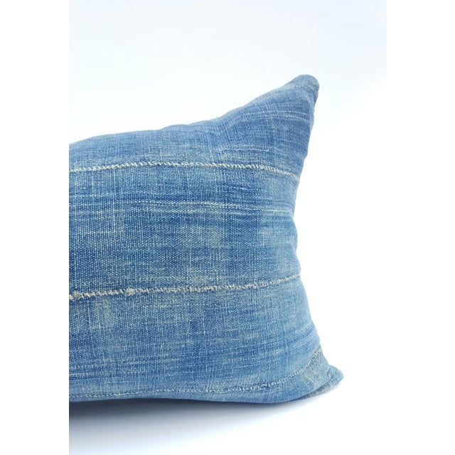 Hand crafted throw pillowcase featuring a vintage, faded denim blue African mud cloth textile! The back fabric is a heavy...