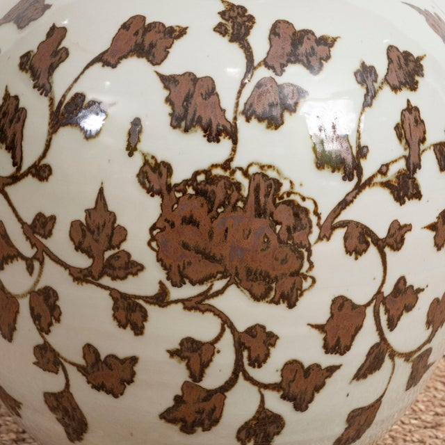 A pair of large brown and white Chinese Export porcelain vases with leaf design.