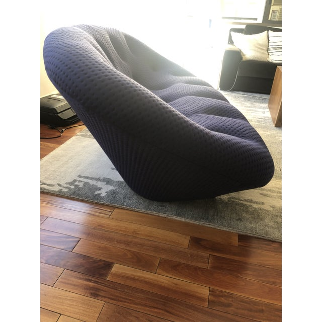 High back Ligne Roset Ploum Sofa in Mood Indigo fabric, tufted and is constructed with a soft stretchable covering over...