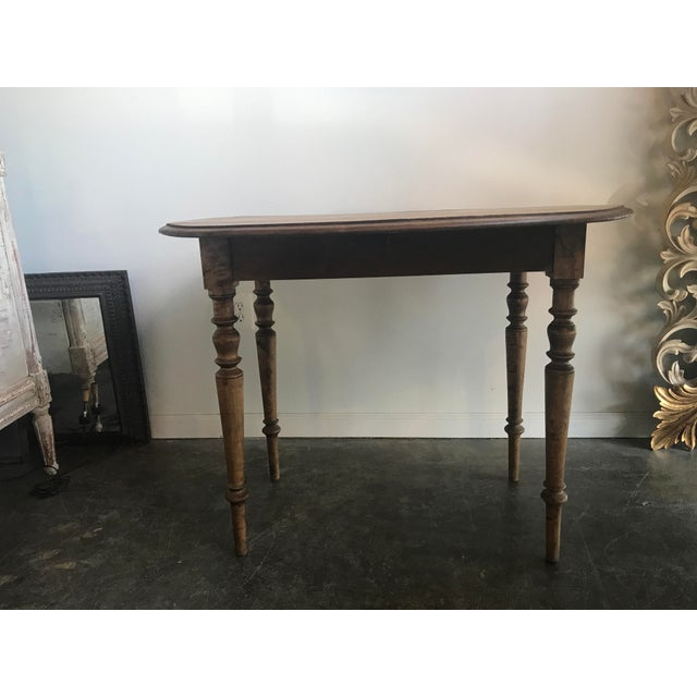 Drop leaf antique wood table. Round table with two fold down leaves. It can sit flat against the wall, be a Demi lune or...