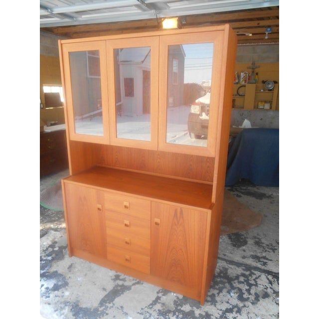 Awesome Mid-Century Danish Modern Two Piece China Display Cabinet. This cabinet is made out of teak. It comes in two...