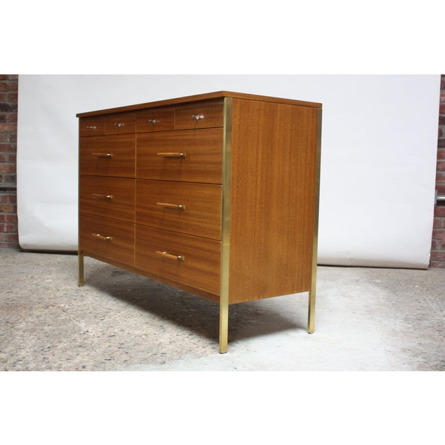 1957 Paul McCobb designed Directional chest for Calvin in bleached mahogany and brass. Despite its relatively diminutive...