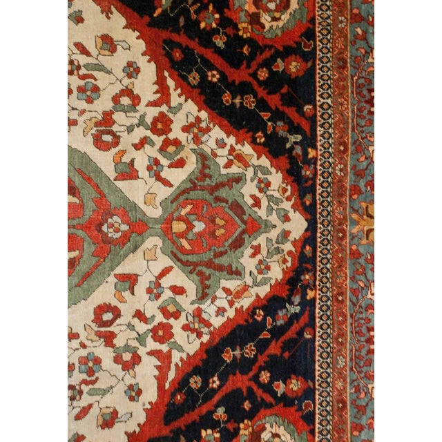 A 19th century Persian Sarouk Farahan rug with a wonderful central medallion with floral and vine pattern on a field of...