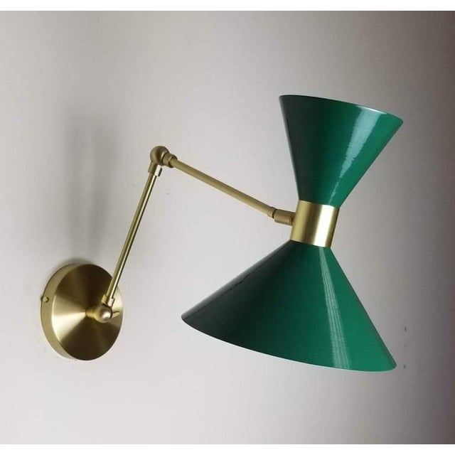 Monarch large scale wall-mount reading lamp or sconce with articulated arms shown in natural brass and our luxe dark green...