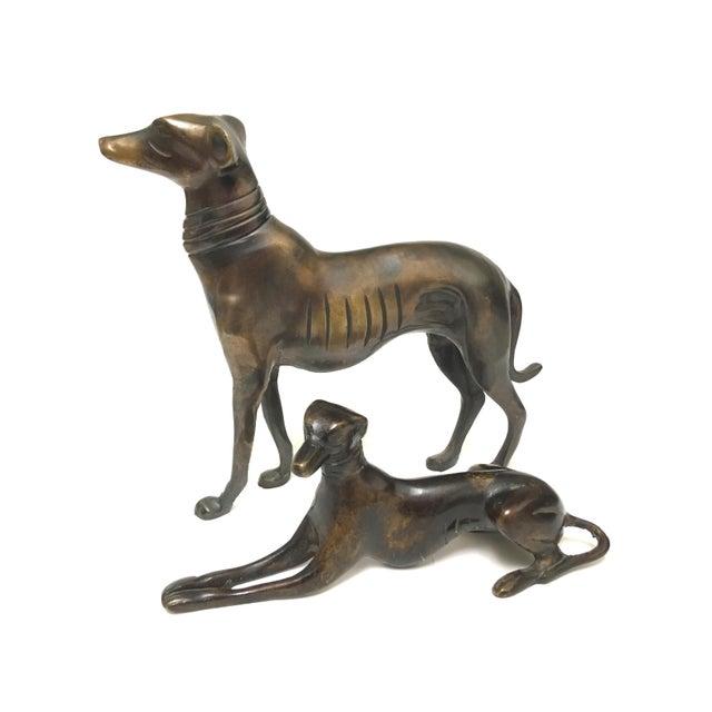 "Bronze Greyhound Figurines Pair Standing Dog : 8"" H x 9"" L x 2.5"" W 2.2 lbs Sitting Dog : 3.5"" H x 2"" W x 5.25"" L 1.2 lb"