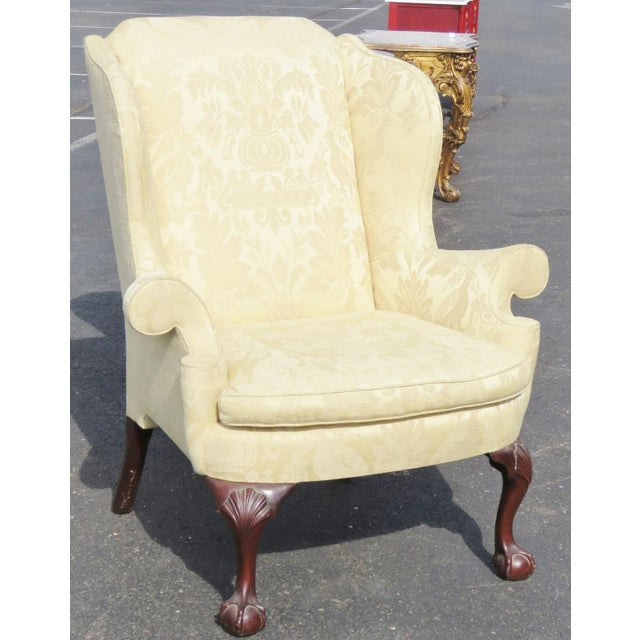 Kindel Winterthal ball and claw wingback chair. Yellow damask upholstery and ball and claw feet. Light wear.