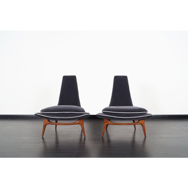 Stunning pair of vintage high back lounge chairs designed by Karpen of California, circa 1950s. Professionally...