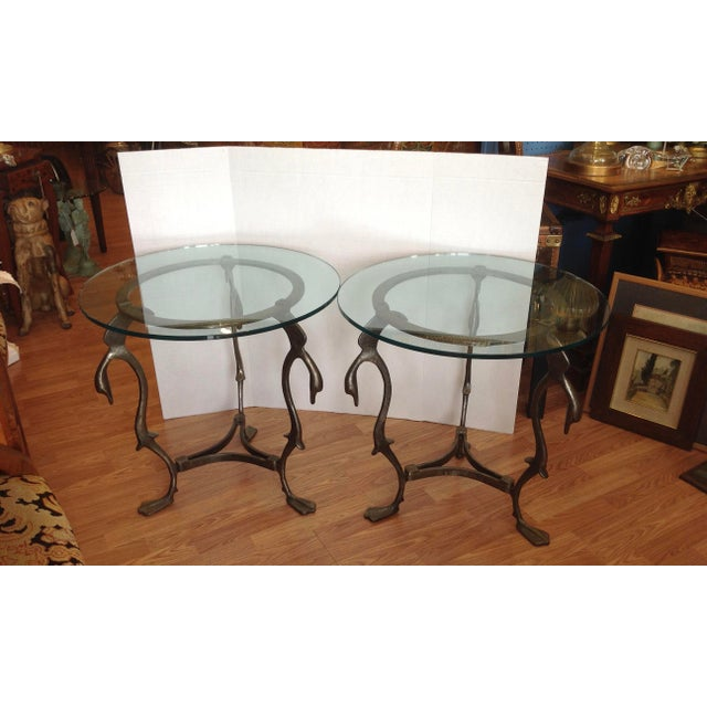 The tables are fashioned from steel and designed with 3 moderne swan form heads at the top; and terminate in web feet at...