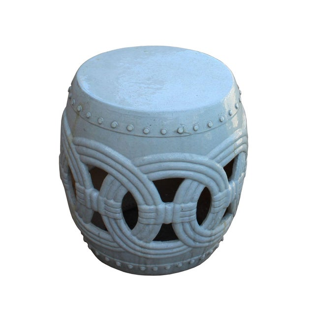 This is a hand made garden clay stool in round shape with oriental Coin ring shape pattern on the body. The surface is...
