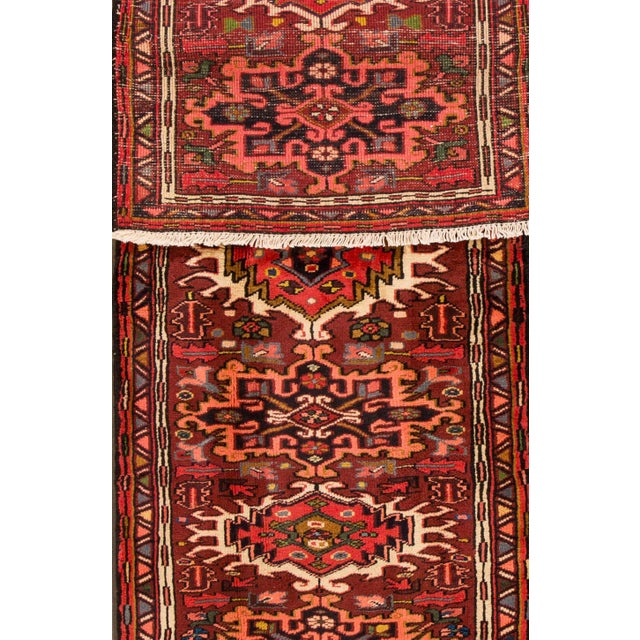 Vintage hand-knotted Persian Heriz rug with a geometric and floral motif. This piece has great detailing and great colors....