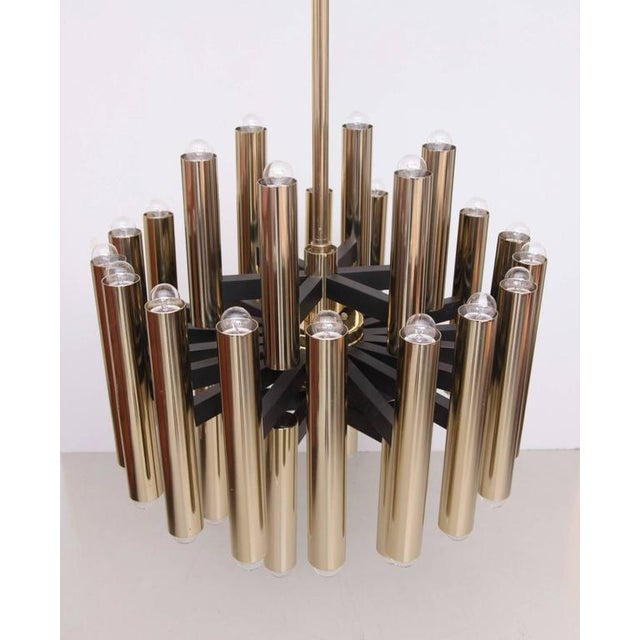 Extraordinary huge 30 x E27 / Model A light brass chandelier produced in high quality in the 1960s. Four of this wonderful...