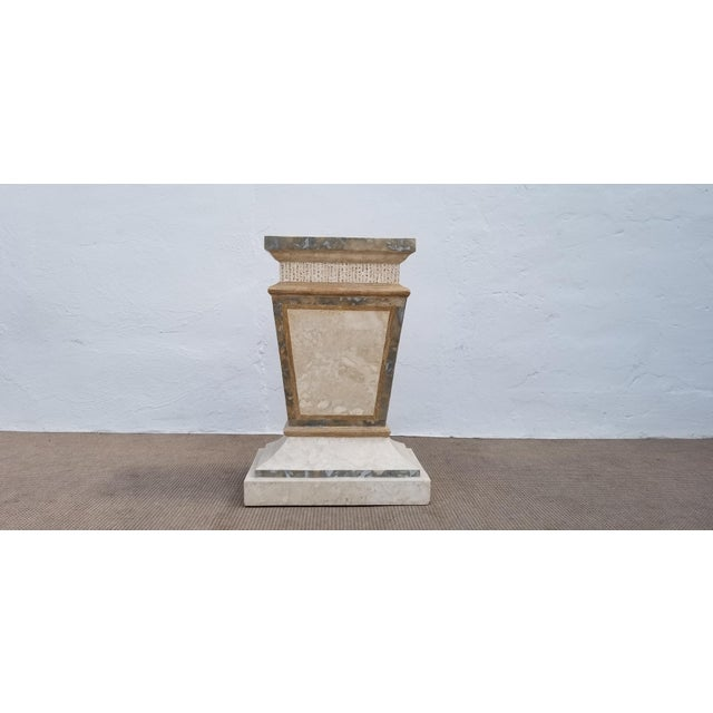An fabulous pedestal base done in multicolored tessellated stone by Maitland Smith. In excellent vintage condition with a...