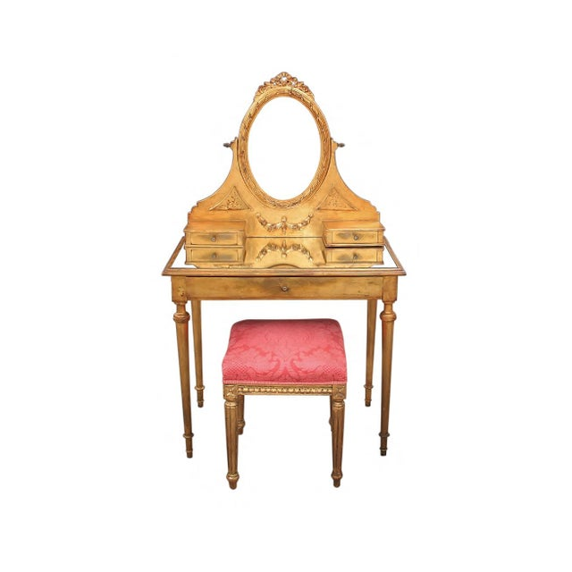 French style gilt mirrored vanity with coordinating stool. A beautiful piece featuring three drawers, carved wood...