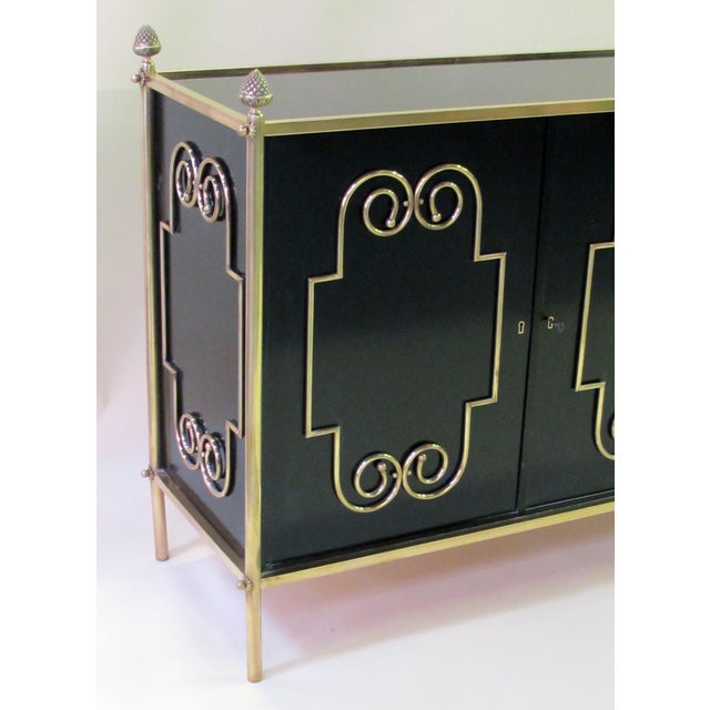 Mid-Century Modern An exquisite American mid-century custom-made black lacquer 3-door sideboard/buffet with applied brass scroll work; by Daniel Jones, Inc. New York For Sale - Image 3 of 5
