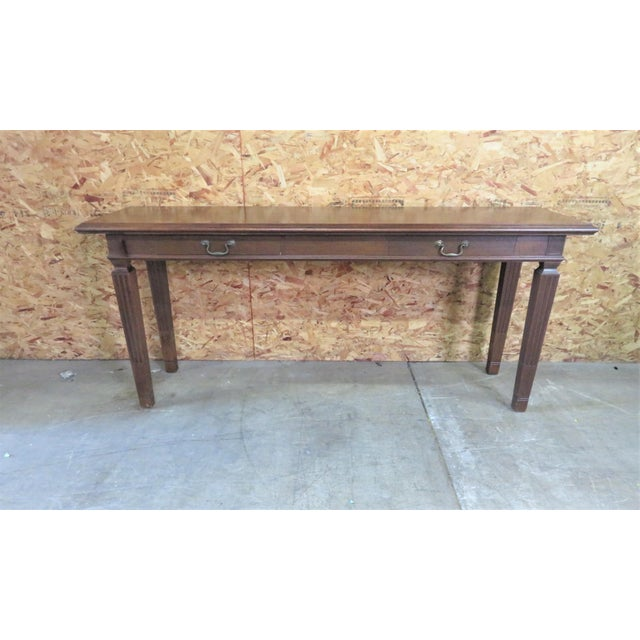 Italian Walnut Console Table with 2 drawer with hand dovetailed construction, brass hardware. Made by the Macke Company.